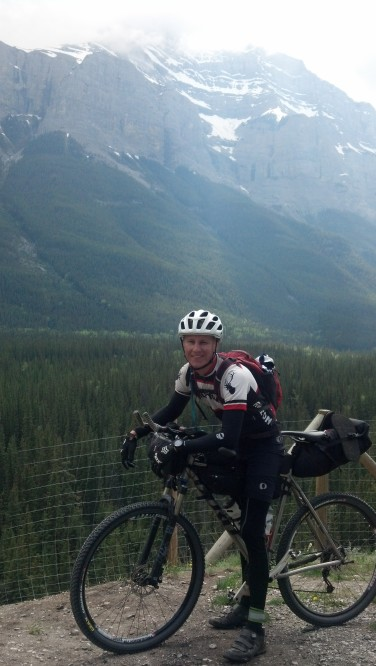Riding into Banff with Jeff Mullen. Photo break.