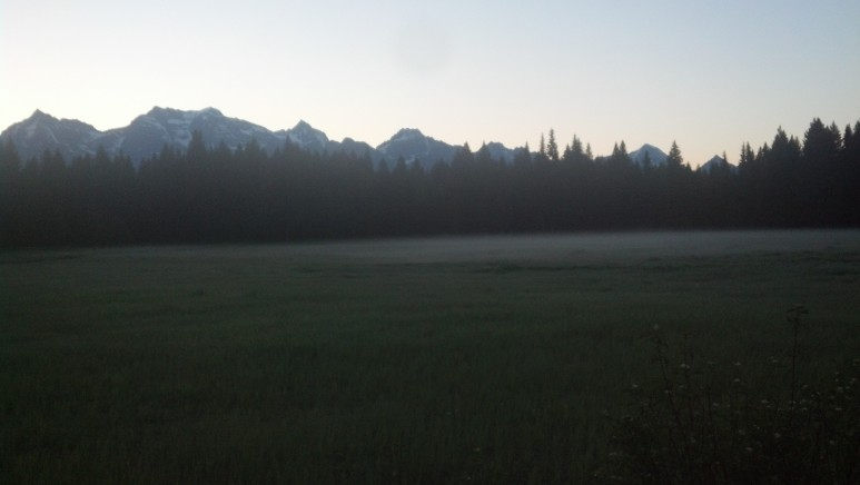 Sunrise on the morning of day 3, those are the mountains of Glacier National Park.  Its 5am and I have been riding 2 hours already.