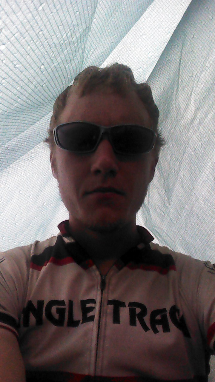 Hiding out a huge thunderhead outside Del Norte.  My makeshift tarp tent, takes 1 minute to setup and be dry.